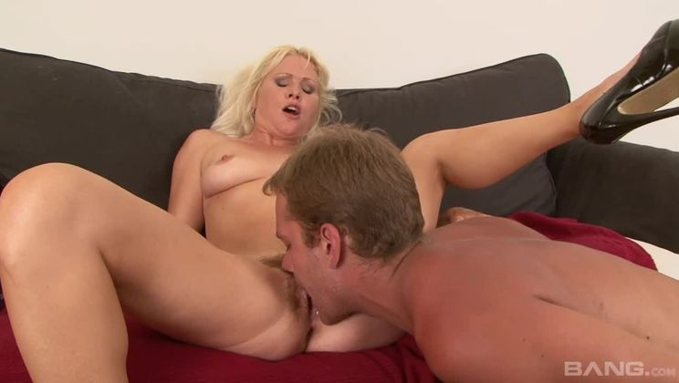 Kathy Anderson jerks him off onto her thick patch of pussy hair
